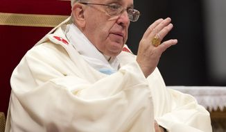 Pope Francis celebrates a mass in St. Peter's Basilica at the Vatican, Wednesday, Jan. 1, 2014. (AP Photo/Andrew Medichini)