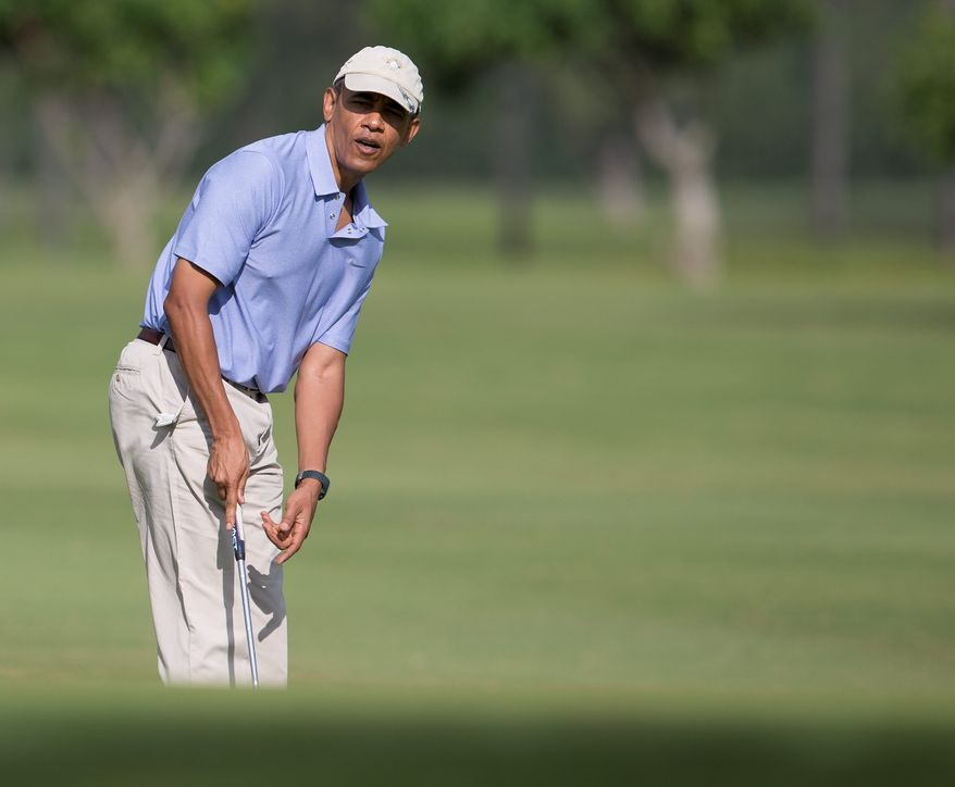 R&R: President Obama gives rare access to a media pool Thursday as he plays his seventh round of golf during his Hawaiian vacation. The first family also has taken two hikes, two beach trips and one snorkeling adventure, but has not attended church, even for Christmas. (Associated Press photographs)
