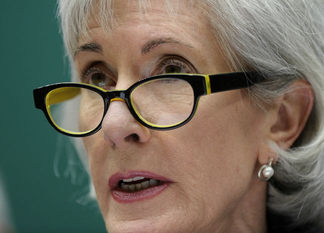 ** FILE ** In this Dec. 11, 2013, file photo, Health and Human Services Secretary Kathleen Sebelius testifies on Capitol Hill in Washington. (AP Photo/Susan Walsh, File)