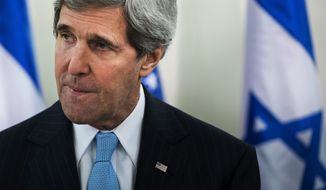 "U.S. Secretary of State John Kerry, left, pauses while speaking before a meeting with Israeli Prime Minister Benjamin Netanyahu before a meeting at the prime minister's office in Jerusalem, Thursday, Jan. 2, 2014. Kerry said that finding peace between Israel and the Palestinians is not ""mission impossible."" (AP Photo/Brendan Smialowski, Pool)"