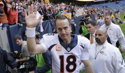 FILE - In this Dec. 22, 2013 file photo, Denver Broncos' Peyton Manning (18) waves to fans following an NFL football game against the Houston Texans in Houston. Manning threw his 51st touchdown pass of the season to set a new NFL record. Manning was the only unanimous choice for the 2013 Associated Press NFL All-Pro team Friday, Jan 3, 2014. It was his seventh time as a first-teamer, tying Hall of Famer Otto Graham for the most by a quarterback. (AP Photo/David J. Phillip)