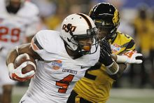 Oklahoma State quarterback J.W. Walsh (4) gets past Missouri defensive back Duron Singleton (2) during the second half of the Cotton Bowl NCAA college football game on Friday, Jan. 3, 2014, in Arlington, Texas. (AP Photo/Brandon Wade)