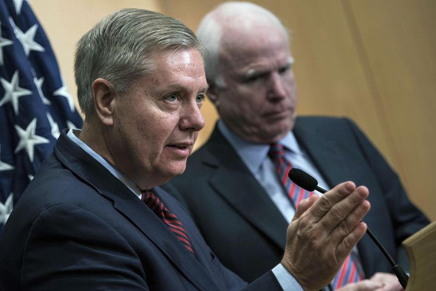 Republican Sens. Lindsey Graham and John McCain: ISIS threatens our homefront. (Associated Press)