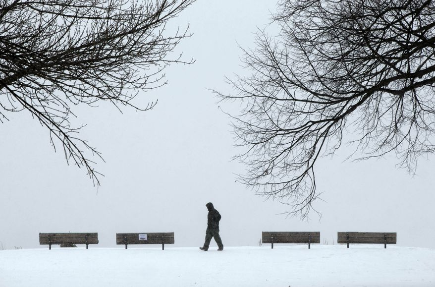 "Daryl Santos, 27, of Los Angeles, Calif., walks through a park while experiencing a snowstorm, Thursday, Jan. 2, 2014,  inPortland, Maine. White-out conditions and a temperature of 0 degrees F greeted Santos on his first trip to the East Coast. Compared to southern California, 'it's an intense change,"" he said.  (AP Photo/Robert F. Bukaty)"