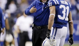 Indianapolis Colts head coach Chuck Pagano gestures to running back Donald Brown (31) during the second half of an NFL wild-card playoff football game Kansas City Chiefs Saturday, Jan. 4, 2014, in Indianapolis. (AP Photo/AJ Mast)