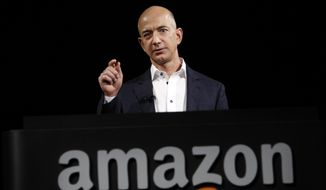 ** FILE ** This Sept. 6, 2012, file photo shows  Jeff Bezos, CEO and founder of Amazon, at the introduction of the new Amazon Kindle Fire HD and Kindle Paperwhite personal devices, in Santa Monica, Calif. (AP Photo/Reed Saxon, File)