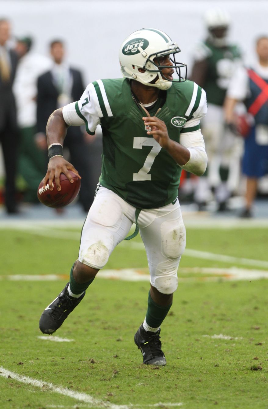 Quarterback Geno Smith #7 of the New York Jets'' plays during a game against  the Miami Dolphins' at Sun Life Stadium in Miami Gardens, Sunday, December 29, 2013. (AP Photo/Marc Serota)