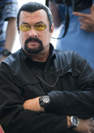 ** FILE ** This June 2, 2013, file photo shows actor Steven Seagal looking on as he waits for a news conference of the U.S. congressional delegation to Russia in the U.S. Embassy in Moscow,  Russia. (AP Photo/Alexander