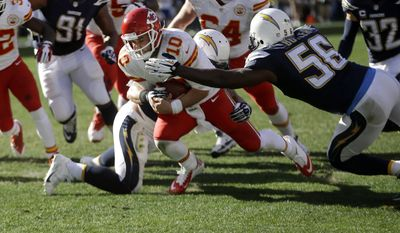 Kansas City Chiefs quarterback Chase Daniel  (10) pushes towards the end zone but can't quite get in as San Diego Chargers inside linebacker Donald Butler (56) and inside linebacker Manti Te'o, behind, haul him down during the first half in an NFL football game, Sunday, Dec. 29, 2013, in San Diego. (AP Photo/Lenny Ignelzi)