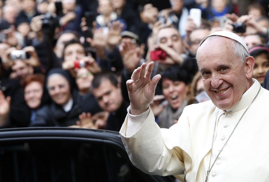 Pope Francis waves as he leaves Rome's Jesus' Church to celebrate a mass with the Jesuits, on the occasion of the order's titular feast, Friday, Jan. 3, 2014. (AP Photo/Riccardo De Luca)
