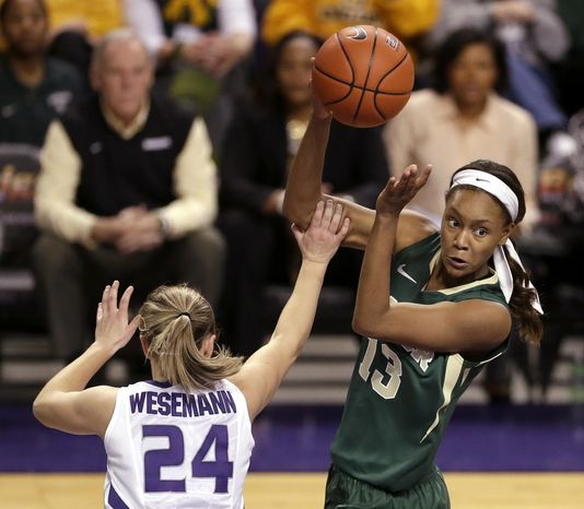 Baylor's Nina Davis (13) passes over the head of Kansas State's Kindred Wesemann (24) during the second half of an NCAA college basketball game Thursday, Jan. 2, 2014, in Manhattan, Kan. Baylor won the game 92-63 (AP Photo/Charlie Riedel)