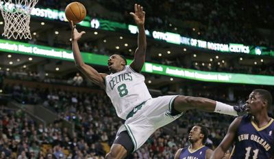 Boston Celtics forward Jeff Green (8) drives to the basket past New Orleans Pelicans guard Jrue Holiday (11) and forward Al-Farouq Aminu, rear, during the third quarter of an NBA basketball game, Friday, Jan. 3, 2014, in Boston. (AP Photo/Charles Krupa)