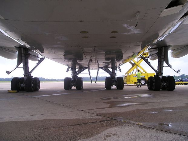 In a desperate attempt to cross borders, some people climb inside the bays holding the landing gear of planes. (Wikimedia Commons)