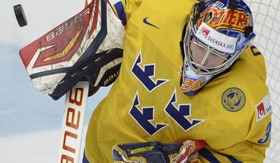 Sweden goaltender Oscar Dansk makes a save during gold medal game action against Finland at the IIHF World Junior Hockey Championship in Malmo, Sweden, Sunday, Jan. 5, 2014. (AP Photo/The Canadian Press, Frank Gunn)