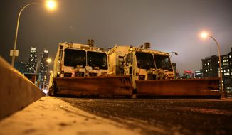 Sanitation trucks mounted with snow plows are parked on the west side of Manhattan in New York, Thursday, Jan. 2, 2014. (AP Photo/Peter Morgan) ** FILE **