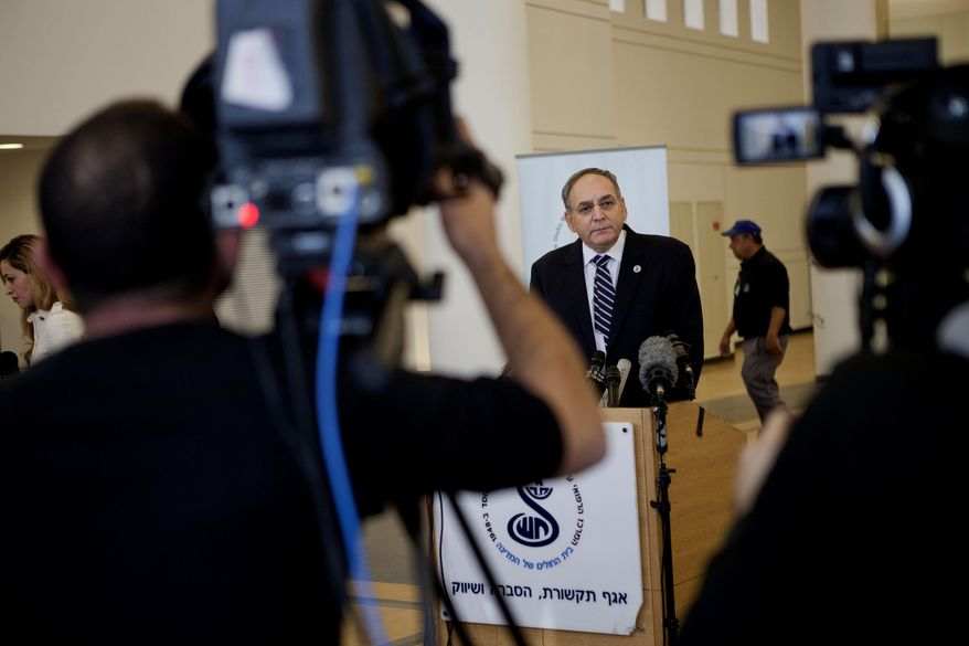 "Zeev Rotstein, the director of Tel Hashomer hospital where the comatose former Israeli prime minister Ariel Sharon is being treated, informs the media about Sharon's health condition at the hospital near Tel Aviv, Israel, Friday, Jan. 3, 2014. Rotstein says the former prime minister's already critical medical condition is deteriorating further and his life remains in danger. The 85-year-old Sharon has been in a coma for eight years after a devastating stroke incapacitated him at the peak of his political power. He was reported in ""critical condition"" Thursday. Rotstein says ""there is a slow and gradual deterioration,"" with doctors now seeing not only Sharon's kidneys but other vital organs malfunctioning as well. (AP Photo/Dan Balilty)"