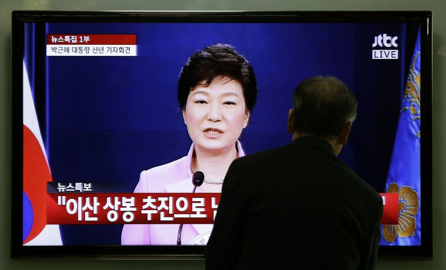 """An elderly man watches a television program airing South Korean President Park Geun-hye's  New Year's speech to the nation, at the Seoul Train Station in Seoul, South Korea, Monday, Jan. 6, 2014. Park called on Monday for resuming reunions of families separated by war, saying it was a chance to improve strained ties between the rival Koreas. Part of the Korean writing in the sentence reads: """"Reunions of separated families"""" (AP Photo/Lee Jin-man)"""