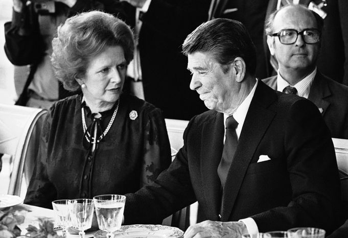"FILE - This is a  Sunday, June 6, 1982 file photo of U.S. President Ronald Reagan and Britain's Prime Minister Margaret Thatcher at the lunch table, at the Palace of Versailles, France. Declassified documents revealed Friday Jan. 3, 2014  how British spies hunted in vain for the creator of a fake recording of British Prime Minister Margaret Thatcher and U.S. President Ronald Reagan. Soviet spies and Argentine agents were considered, but an anarchist punk band later claimed responsibility. The tape, sent to Dutch newspapers in 1983, purported to capture the leaders sparring during the 1982 Falklands War. A transcript shows Reagan urging Thatcher ''to control yourself,"" and the British leader responding: ""We have to use violence"" against Argentina. British authorities quickly identified the recording as a forgery. A Foreign Office adviser said the MI6 intelligence agency had considered Soviet or Argentine agents and British leftists as possible culprits. (AP Photo/ File)"