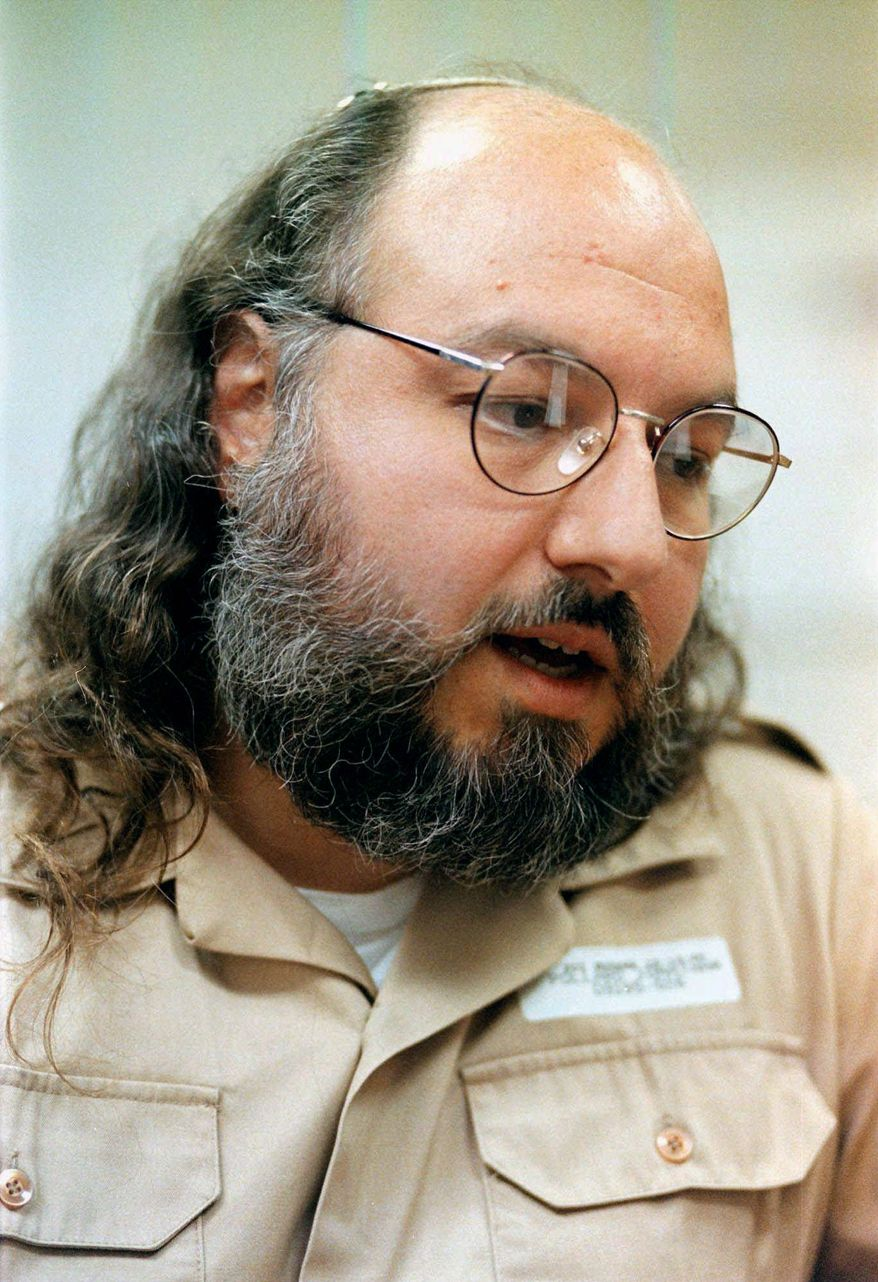 ** FILE ** Jonathan Pollard, seen in 1998, was sentenced to life in prison in 1987 for providing classified information to Israel. Citing unidentified sources, an Israeli television station reported that Secretary of State John F. Kerry was offering to free Pollard if Israel released Israeil-Arab prisoners. (Associated Press)