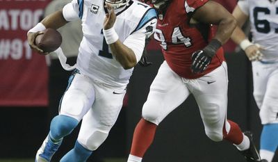 Carolina Panthers quarterback Cam Newton (1) breaks out of the pocket against Atlanta Falcons defensive tackle Peria Jerry (94) during the first half of an NFL football game, Sunday, Dec. 29, 2013, in Atlanta. (AP Photo/Dave Martin)
