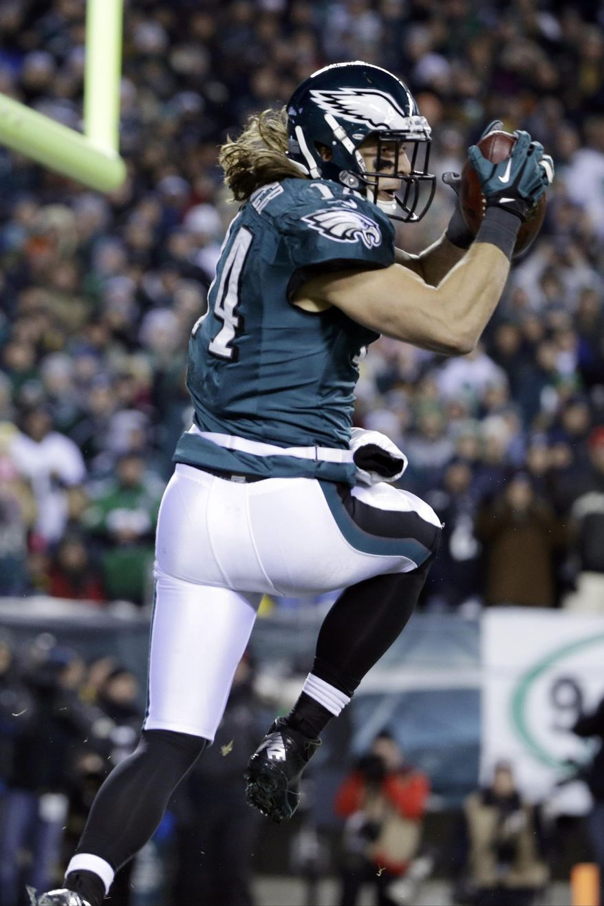 Philadelphia Eagles' Riley Cooper scores a touchdown during the first half of an NFL wild-card playoff football game against the New Orleans Saints, Saturday, Jan. 4, 2014, in Philadelphia. (AP Photo/Matt Rourke)