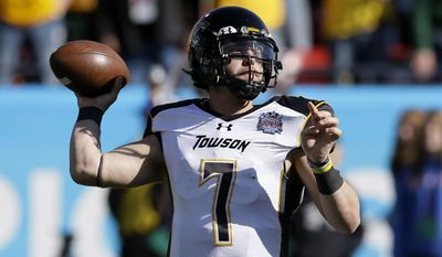 Towson quarterback Peter Athens (7) passes in the first half of the FCS championship NCAA college football game against North Dakota State, Saturday, Jan. 4, 2014, in Frisco, Texas. (AP Photo/Tony Gutierrez)