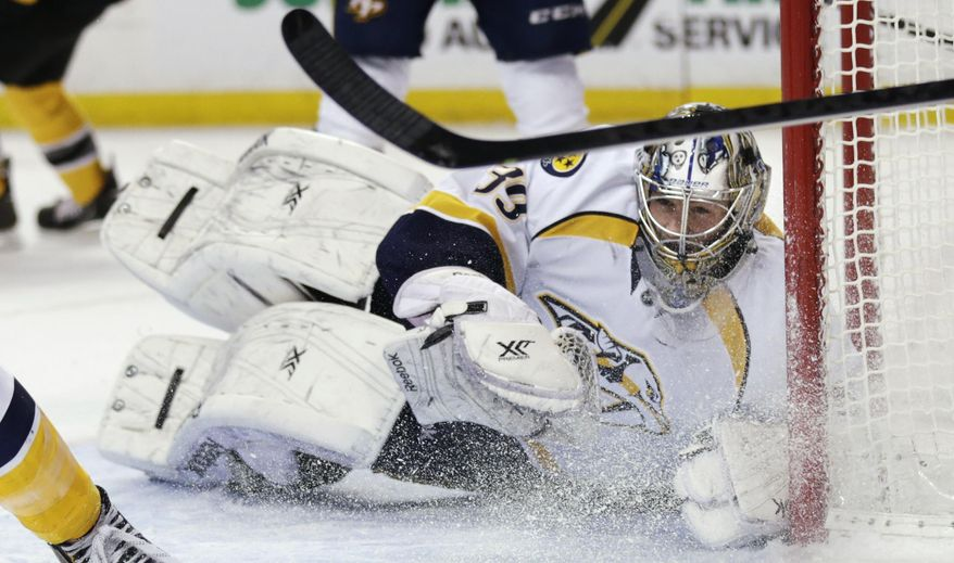Nashville Predators goalie Marek Mazanec loses his stick as he drops to the ice on a save against the Boston Bruins during the second period of an NHL hockey game, Thursday, Jan. 2, 2014, in Boston. (AP Photo/Charles Krupa)