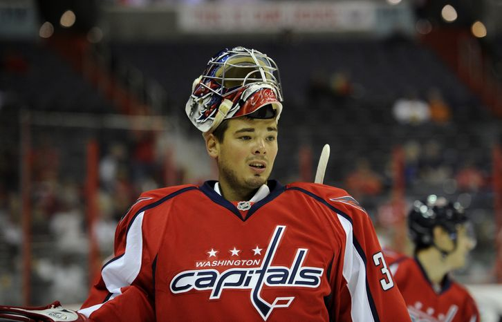 Washington Capitals goalie Michal Neuvirth (30), of the Czech Republic, looks on during warm ups before an NHL preseason hockey game against the Chicago Blackhawks, Friday, Sept. 20, 2013, in Washington. The Blackhawks won 5-4 in a shootout. (AP Photo/Nick Wass)