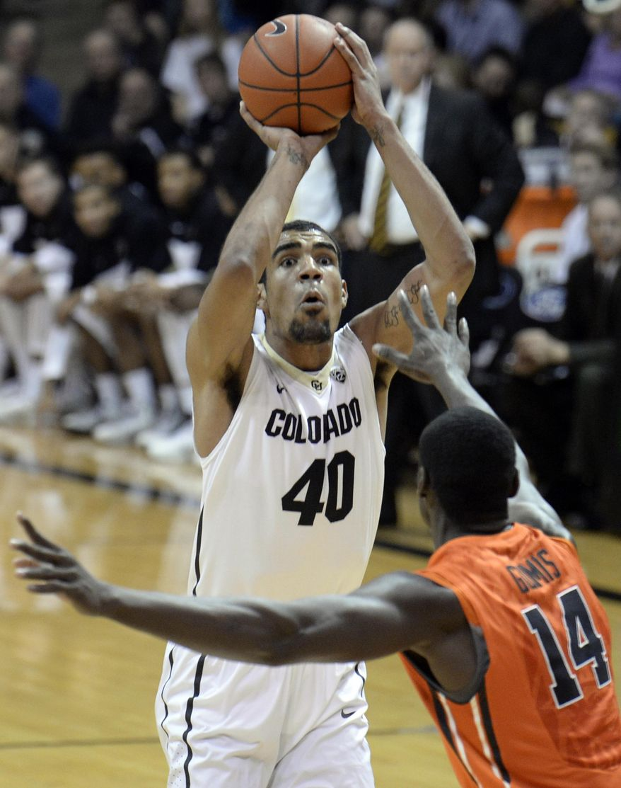 Colorado's Josh Scott takes a shot over Oregon State's Daniel Gomis during an NCAA college basketball game Thursday, Jan. 2, 2014, in Boulder, Colo. (AP Photo/Daily Camera, Jeremy Papasso) NO SALES