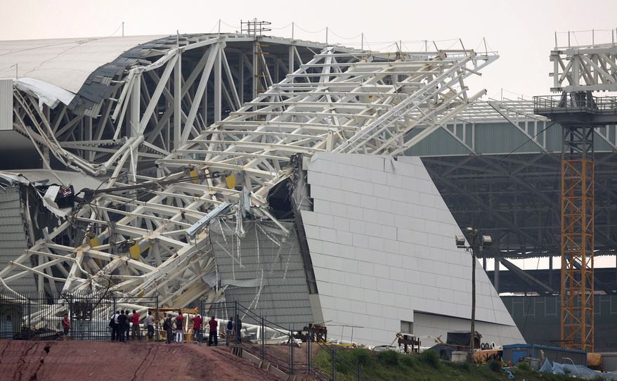 FILE - In this Nov. 27, 2013 file photo, a buckled metal structure sits on a part of the Itaquerao Stadium in Sao Paulo, Brazil. A news report cites Sao Paulo state Labor Ministry official Luis Antonio Medeiros as saying the man who operated the crane that collapsed at the city's World Cup stadium had worked 18 days in a row. Two construction workers were killed in the accident, which remains under investigation. The stadium is slated to host the 2014 World Cup opener. (AP Photo/Andre Penner, File)