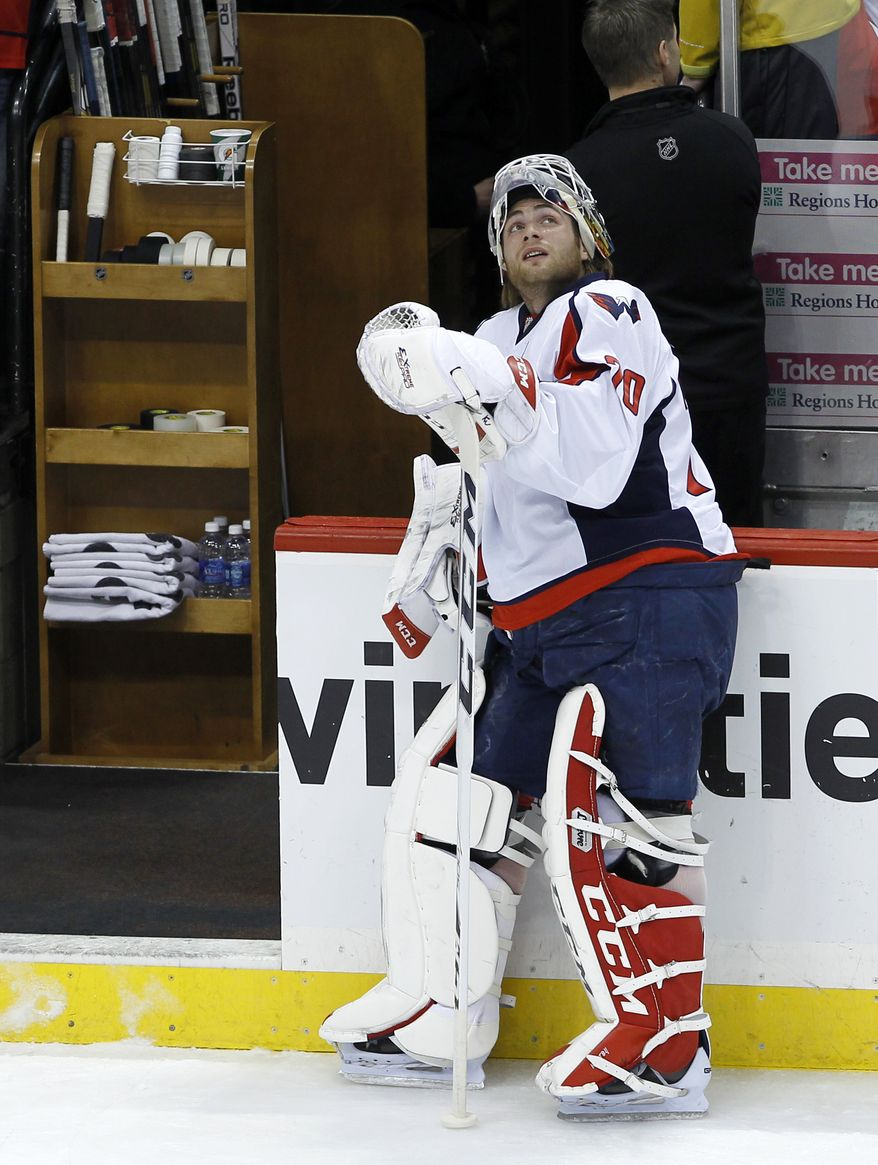 Washington Capitals goalie Braden Holtby looks up at the scoreboard prior to an NHL hockey game against the Minnesota Wild in St. Paul, Minn., Saturday, Jan. 4, 2014.   (AP Photo/Ann Heisenfelt)