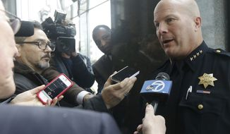 San Francisco Police Chief Greg Suhr, right, speaks to reporters after a news conference in San Francisco, Monday, Jan. 6, 2014. The FBI says a Chinese national has been arrested in the investigation of a fire set intentionally at the Chinese Consulate in San Francisco. (AP Photo/Jeff Chiu)