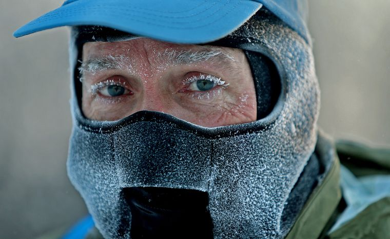 """** FILE ** John Brower snow in his eye lashes after running to work in the frigid -20 weather Monday, Jan. 6, 2014, in Minneapolis. A whirlpool of frigid, dense air known as a """"polar vortex"""" descended Monday into much of the U.S. (AP Photo/The Star Tribune,  Elizabeth Flores)"""