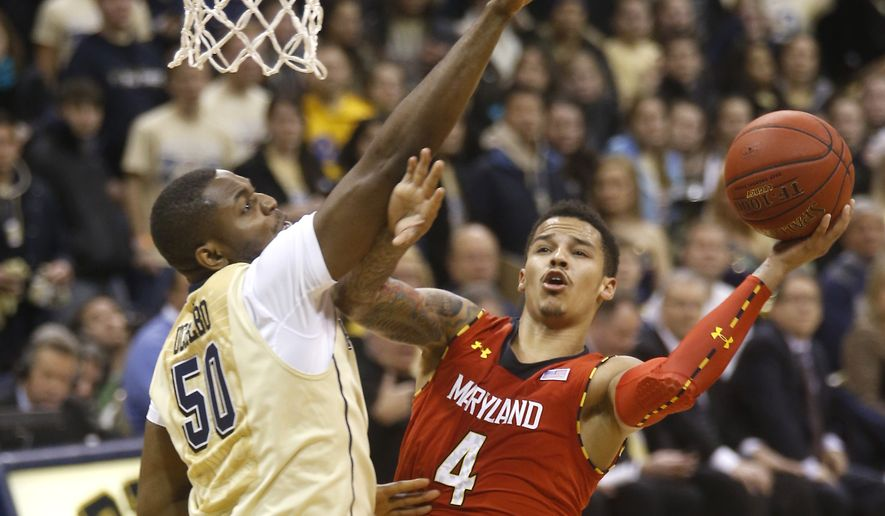 Maryland's Seth Allen (4) puts up a shot around Pittsburgh's Joseph Uchebo (50)in the second half of an NCAA college basketball game on Monday, Jan. 6, 2014, in Pittsburgh. Pittsburgh won 79-59.(AP Photo/Keith Srakocic)