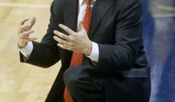 Maryland head coach Mark Turgeon kneels on the court in the second half of an NCAA college basketball game against Pittsburgh on Monday, Jan. 6, 2014, in Pittsburgh. Pittsburgh won 79-59.(AP Photo/Keith Srakocic)