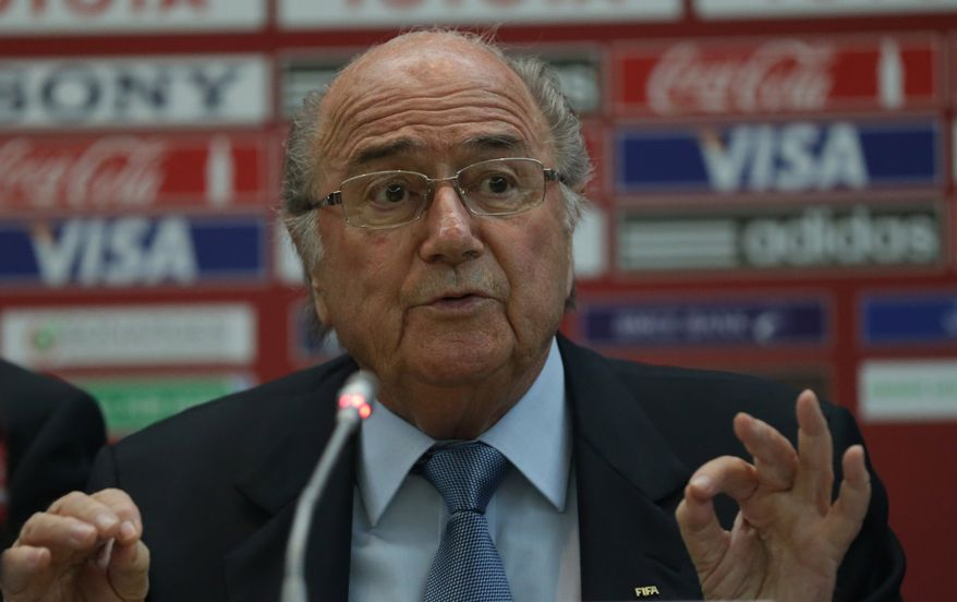 FIFA president Joseph Sepp Blatter attends  a news conference at the Club World Cup soccer tournament in Marrakech, Morocco, Thursday, Dec. 19, 2013. (AP Photo/Matthias Schrader)