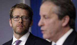 White House press secretary Jay Carney listens at left, as White House National Economic Council Chairman Gene Sperling speaks during the daily briefing at the White House in Washington, Monday, Jan. 6, 2014. With Congress back, the Senate is expected to work on a three-month extension of benefits for the long-term unemployed.  (AP Photo/Susan Walsh)