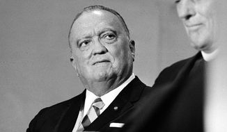 FILE -  This is a 1971 file photo of the late  F.B.I. director J. Edgar Hoover. Overstaffed, overconfident and all too often over here. That's how a top British spymaster saw his American counterparts at the FBI and CIA, according to newly declassified diaries from the years after World War II. Friction between British spies and their American colleagues is a recurring theme in journals kept by Guy Liddell, the postwar deputy director of Britain's domestic intelligence agency, MI5. (AP Photo/File)