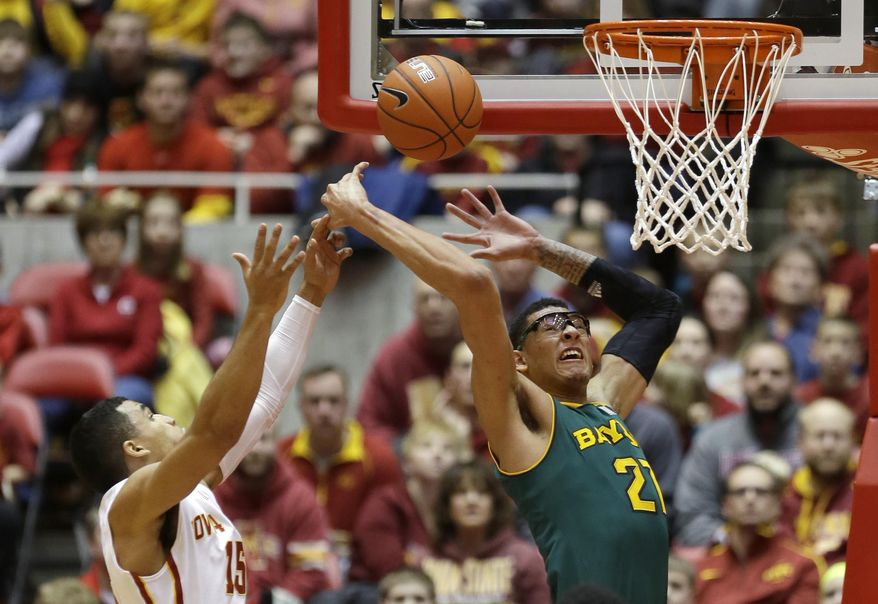 Baylor center Isaiah Austin, right, fights for a rebound with Iowa State guard Naz Long during the first half of an NCAA college basketball game, Tuesday, Jan. 7, 2014, in Ames, Iowa. (AP Photo/Charlie Neibergall)