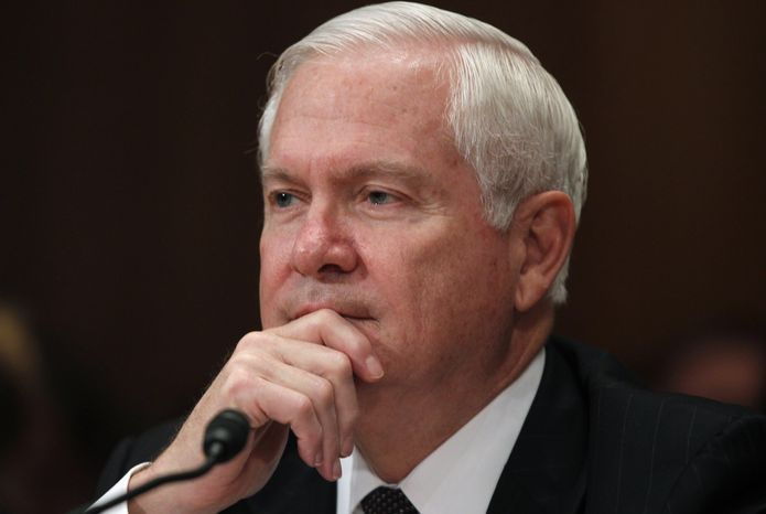 FILE - In this June 15, 2011, file photo, then-Secretary of Defense Robert Gates testifies regarding the Department of Defense Fiscal Year 2012 budget request before the Senate Appropriations Committee Subcommittee on Defense on Capitol Hill in Washington. Gates asserts in a new memoir that President Barack Obama grew frustrated with U.S. policy in Afghanistan and that Vice President Joe Biden has been wrong on nearly every foreign policy and national security issue. He also accuses members of Congress of inquisition-like treatment of administration officials.  (AP Photo/Charles Dharapak, File)