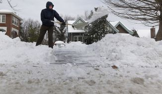 Ralph Wafer clears his driveway of snow outside his home Tuesday, Jan. 7, 2014, in St. Louis. As Missourians muddled through another frigid day Tuesday, the worst cold snap in nearly two decades was about to come to an end but many roads remained partly snow-covered two days after a winter storm dumped several inches of snow. (AP Photo/Jeff Roberson)