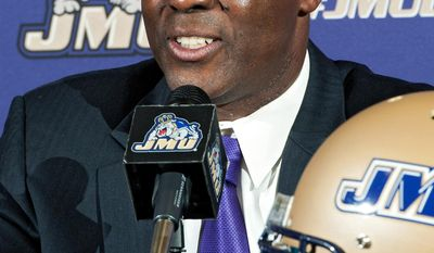 James Madison's new football coach, Everett Withers, speaks during a news conference at which he was officially introduced, Tuesday, Jan 7, 2014, in Harrisonburg, Va. Withers as defensive coordinator at Ohio State. (AP Photo/Daily News-Record, Jason Lenhart)