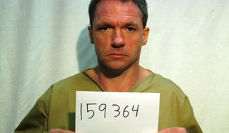 This undated photo provided by Kentucky Department of Corrections, Robert Vick is shown.  Authorities say Vick, an inmate, escaped from a minimum security facility in Lexington on Sunday, Jan. 5, 2014. As temperatures dropped into the low single digits Monday, they say he walked into a motel and asked the clerk to call police. Lexington police spokeswoman Sherelle Roberts says 42-year-old Vick of Hartford told the clerk he wanted to turn himself in and escape the arctic air. Roberts says Vick was checked out by paramedics and returned to Blackburn Correctional Complex. Wind chill readings were 20 below zero Monday in Lexington. (AP Photo/Kentucky Department of Corrections)