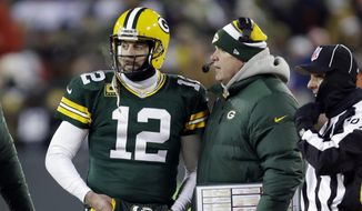 Green Bay Packers head coach Mike McCarthy talks to the Packers quarterback Aaron Rodgers (12) during the first half of an NFL wild-card playoff football game against the San Francisco 49ers, Sunday, Jan. 5, 2014, in Green Bay, Wis. (AP Photo/Mike Roemer)