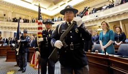 Members of the Virginia Capitol Police retire the colors during opening ceremonies of the General Assembly in Richmond. The election of a state senator from Norfolk was too close to call Wednesday. (associated press)