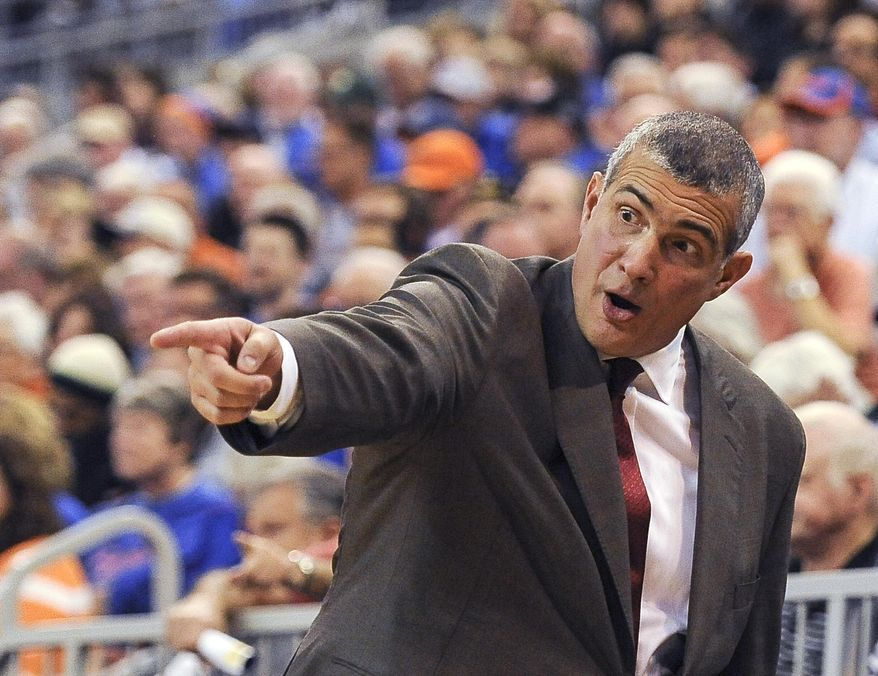 South Carolina coach Frank Martin points to the court as he talks to his team on the bench during the first half of an NCAA college basketball game against Florida, Wednesday, Jan. 8, 2014 in Gainesville, Fla. (AP Photo/Phil Sandlin)