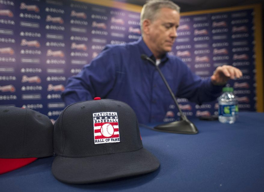 Former Atlanta Braves pitcher Tom Glavine gets up from a news conference at Turner Field on Wednesday, Jan. 8, 2014, in Atlanta. Glavine, former Braves teammate Greg Maddux and Frank Thomas were elected to baseball's Hall of Fame on Wednesday. (AP Photo/John Amis)