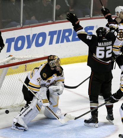 Anaheim Ducks left wing Patrick Maroon celebrates Mathieu Perreault's goal past Boston Bruins goalie Tuukka Rask during the second period of an NHL hockey game in Anaheim, Calif., Tuesday, Jan. 7, 2014. (AP Photo/Chris Carlson)