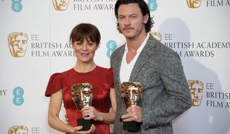 British actors Helen McCrory, left, and Luke Evans pose for photographers ahead of the EE British Academy Film Awards Nominations announcement in London, Wednesday, Jan. 8, 2014. (Photo by Jonathan Short/Invision/AP)