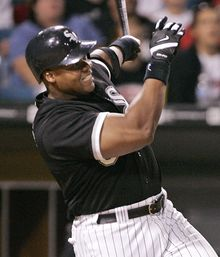 Chicago White Sox's Frank Thomas follows through on a three-run home run scoring Scott Posednik and Tadahito Iguchi during the eighth inning, Tuesday, July 5, 2005, in Chicago. The White Sox won 6-4. (AP Photo/Brian Kersey)